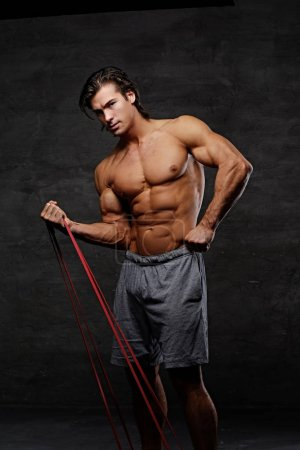 Athletic man with fitness trx straps