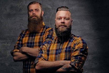 Two bearded men with crossed arms