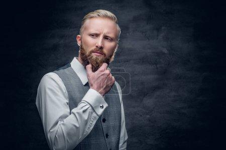 A stylish bearded blond man