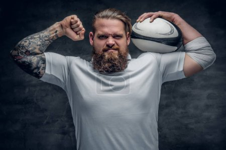 Rugby player holding the game ball