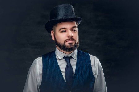 Bearded man in a waistcoat and a cylinder hat