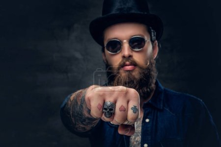 Photo for Close up tattooed hipster's fingers with ring - Royalty Free Image