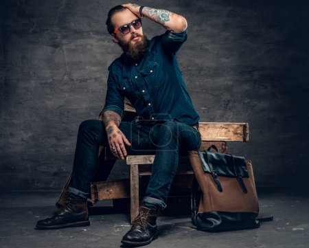 Stylish man in a jeans and sunglasses