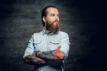 Bearded man with crossed arms