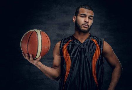 Black man posing with basket ball