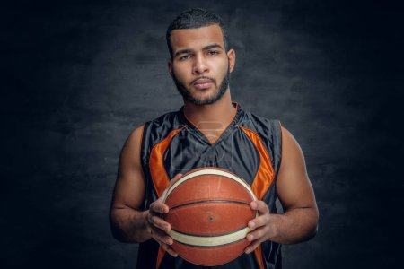 Black man posing with basket ball