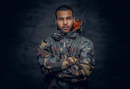 Black man dressed in military jacket