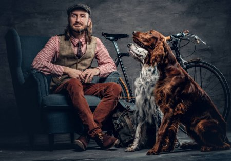 irish man posing with dogs