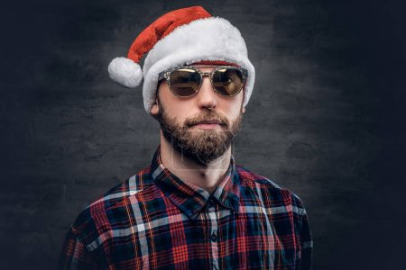 Photo for Portrait of bearded man wearing Santa's hat. - Royalty Free Image