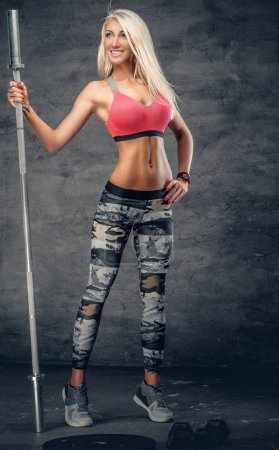 Attractive blonde woman holds barbell