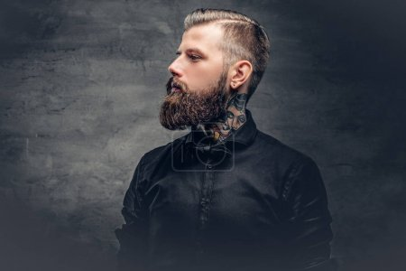 Photo for Handsome bearded man with tattoo on his neck. - Royalty Free Image