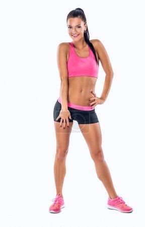 Sporty female fitness model.
