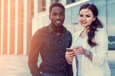 Black male and woman in a downtown
