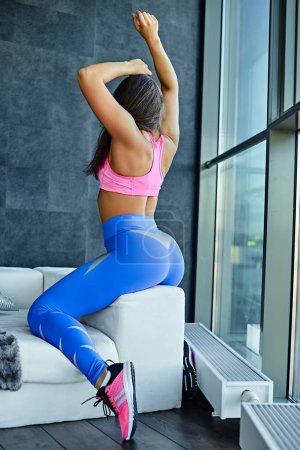 Female holds fitness rubber strips
