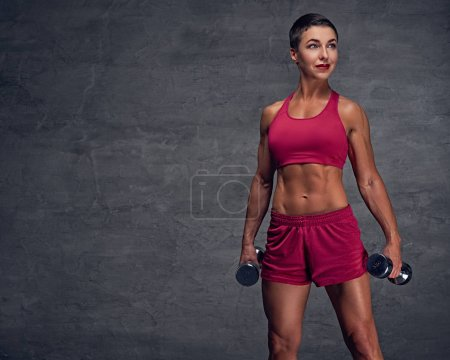 Middle age female holds dumbbells