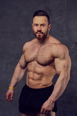Shirtless bearded bodybuilder