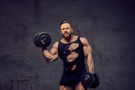 Man doing biceps workout with dumbbells