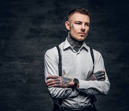 Man with a tattoos and crossed arms