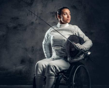 Female paralympic wheelchair fencer