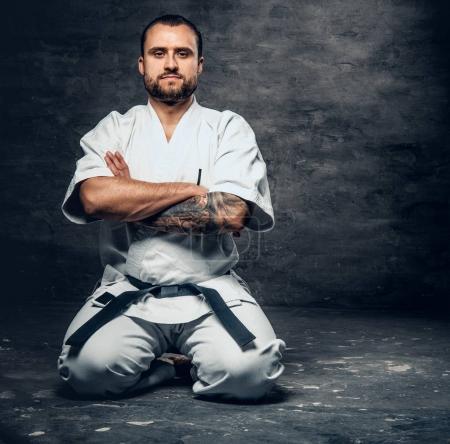 Karate fighter dressed in a white kimono