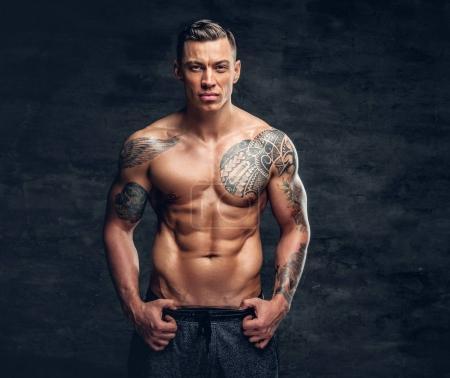 Suntanned shirtless muscular man