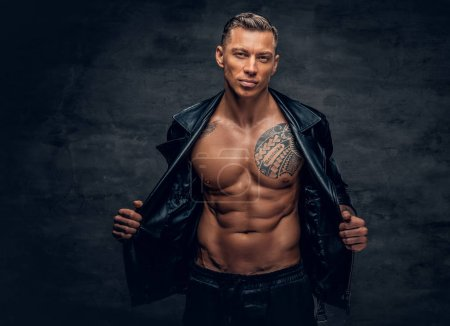 Handsome man with tattoo on a chest