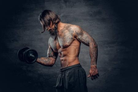 Shirtless man doing a biceps workout