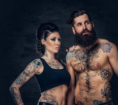 Tattooed bearded man and brunette woman