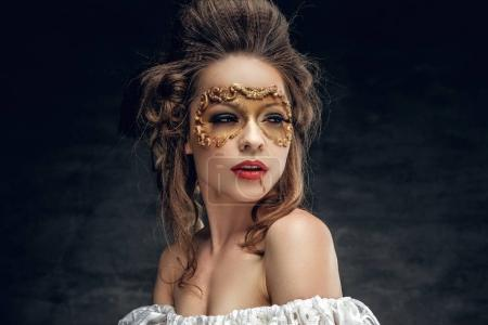 Female with Carnaval golden mask