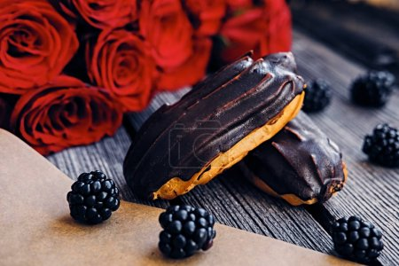 Chocolate eclairs with berries