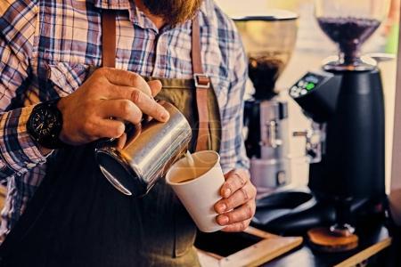Man preparing cappuccino