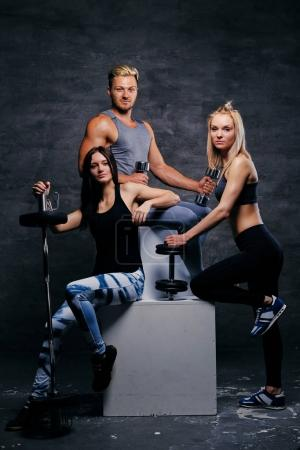 Sporty women and an athletic man