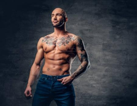 Shirtless man with tattooed torso