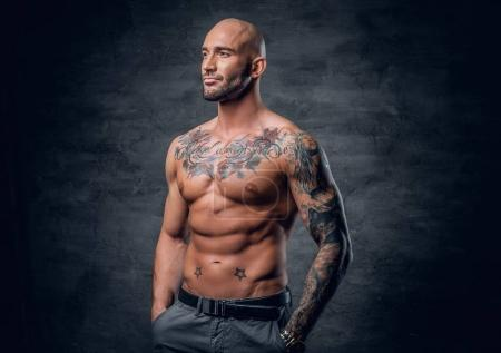 Shirtless muscular man with tattoos