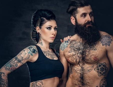 Tattooed male and brunette female