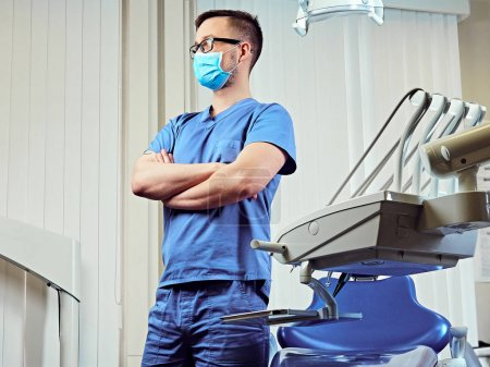 Dentist in a room with medical equipment