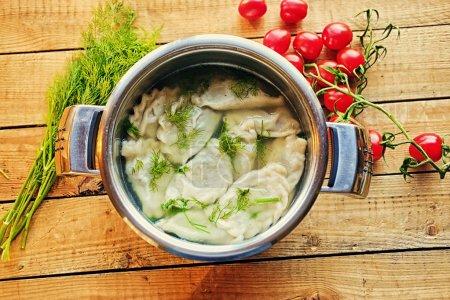 Boiled dumplings with parsley