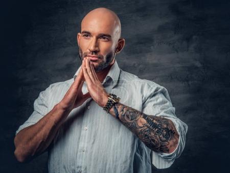 Praying shaved head man