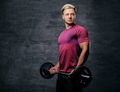 Athletic blond man doing a biceps workout