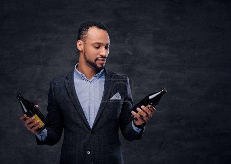 Black man holding beer bottles
