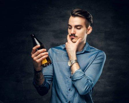 Man holds craft bottled beer