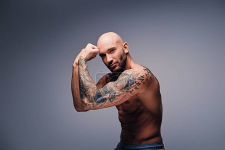 Muscular man with tattooed torso