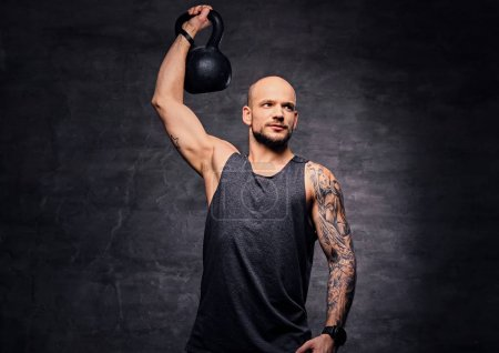 Athletic man with the Kettlebell