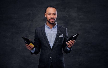 Black man holding beer bottles