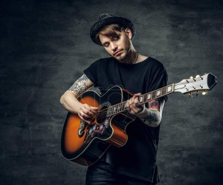 Young guitarist with tattoos