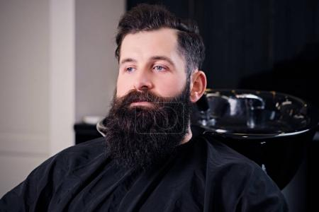 Bearded man in a hairdresser's salon