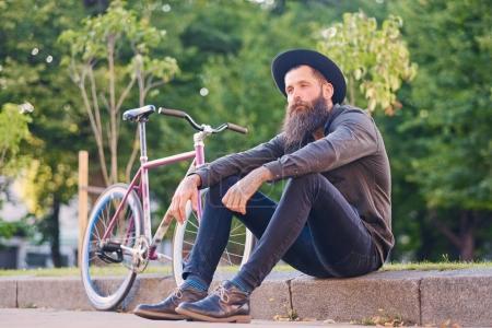 Bearded tattooed man in a hat