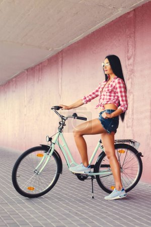 Sporty female in denim shorts
