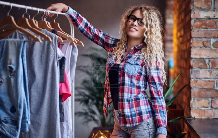 Woman chooses fashionable clothes