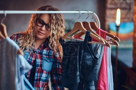 Female chooses fashionable clothes